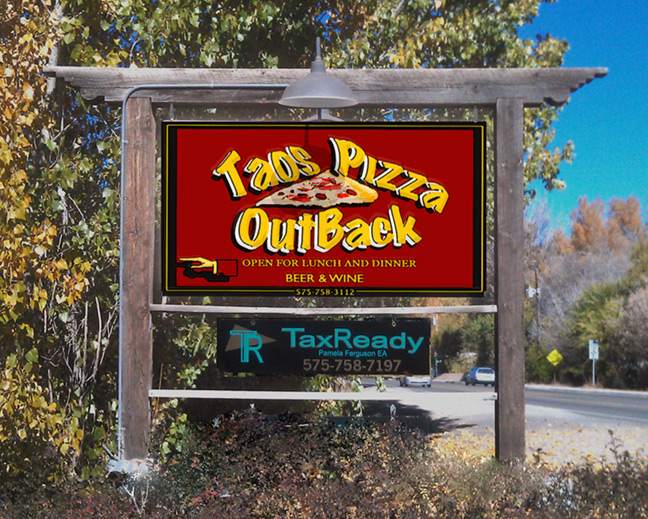 Taos Pizza Out Back Sign